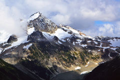 Mountain summit. The snow is covering the summit of these mountains Royalty Free Stock Image