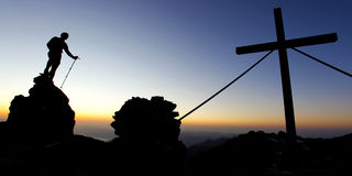 Mountain summit. Silhouette of a man on a mountain summit at dawn Stock Photos