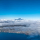 Mountain summit above clouds, Pico del Teide Royalty Free Stock Image