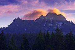 Mountain summit at dawn. Mountain landscape with a colorful top and the clouds at dawn Stock Photo