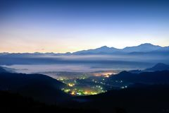 Night scene image of city lights and mist among mountains stock image