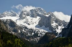 Mountain summits. Massif Dachstein with from lake Vorderer Gosausee stock photo