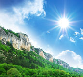 Mountain and sun in sky Stock Photo