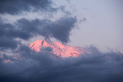 Mountain at sunrise. Ararat mountain at sunrise covered with clouds Stock Photo