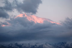 Mountain at sunrise. Ararat mountain at sunrise covered with clouds Stock Images