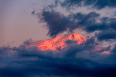 Mountain at sunrise. Ararat mountain at sunrise covered with clouds. View on Turkey from Armenia Stock Photography