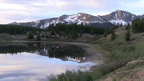 Mountain Sunrise Reflection. A scenic sunrise reflected in a Colorado mountain lake stock video
