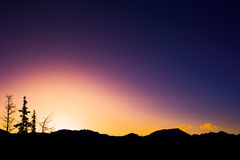 Mountain Sunrise silhouettes Stock Photography