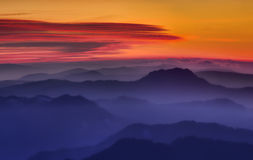 Mountain sunset. Mystic red mountain sunset with fog Stock Photos