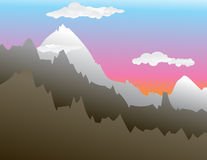Mountain Sunset. A mountain sunset scene with a few clouds floating about Stock Image