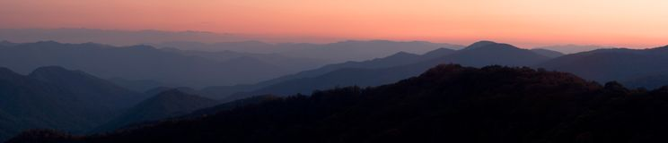 Mountain Sunset Panorama. An evening sunset over the peaks and valleys of the Great Smoky Mountains Nat. Park, USA.  Stitched panorama of ~23 Megapixels Royalty Free Stock Images