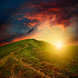 Mountain sunset with red clouds Royalty Free Stock Images