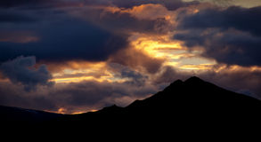 Mountain Sunset. Setting sun silhouettes the mountains of Fiordland, New Zealand Stock Photography
