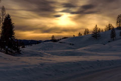 Mountain sunset snow sun winter Royalty Free Stock Images