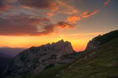 Mountain sunset summer. Beautiful sunset in the summer  landscape of the mountain Royalty Free Stock Image