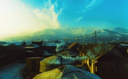 Mountain sunset village stock photo