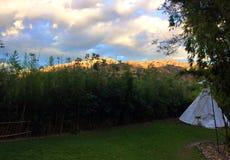 MOUNTAIN TEEPEE TENT. Outdoor camping in Ecuador with mountain views stock photo