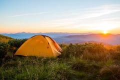 Mountain tent, sunrise on the ridge, tracking Royalty Free Stock Image