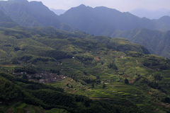 Villages and layers of terraced fields on the mountain Royalty Free Stock Images