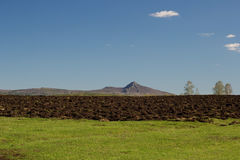 Mountain and tilled ground. Landscape with mountain and tilled ground Royalty Free Stock Photo