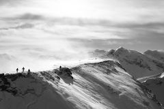 Mountain Top. A black and white picture, which describe the splendid landscape of the moutain top of Alps in snowing winter. it also shows the spirit of people Stock Images