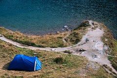 Mountain top. adventures Camping tourism and tent. landscape near water outdoor at Lacul Balea Lake, Transfagarasan, Romania. stock image