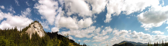 Mountain top. Bright sunny summer day,blue sky with some clouds, mountain top view from below Stock Photography