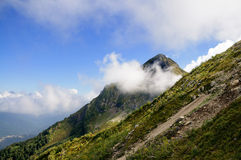 Mountain top in the clouds. Royalty Free Stock Image