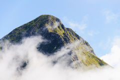 Mountain top in the clouds. Stock Image
