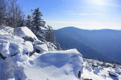 Mountains covered snow at sunny day Stock Photography