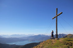 Mountain top with cross, lookout point to the alps Stock Photography