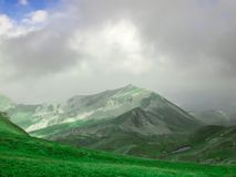 A mountain top and a glacial lake stock photos