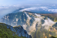 Mountain top landscape with clouds. Landscape with a mountain top over the clouds in the Romanian Carpathians Royalty Free Stock Images