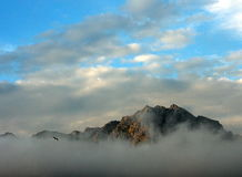 Mountain top. Over clouds Lofoten, Norway Stock Images