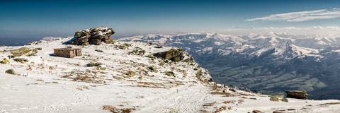Mountain Top Snow Landscape. This is a mountain landscape panorama in the basque region of southern France. There is a lone cabin in the snow covered foreground Royalty Free Stock Photos