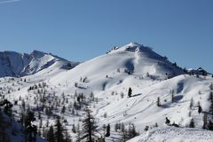 Mountain top with snowmobile traces Stock Photography