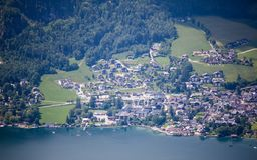 Village aside St. Wolfgang Lake. At mountain top of St. Wolfgang lake Stock Images