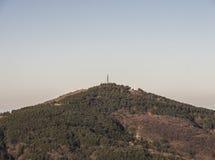 Mountain top with a telecommunication antenna stock photo