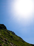 Mountain top under bright sunshine Stock Photography