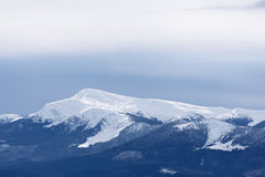 Mountain top under snow Royalty Free Stock Photos