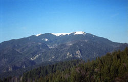 Mountain top view. View of mountain top covered in white snow, deep blue sky. 35mm film scan Royalty Free Stock Photo