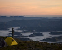 Mountain top view. With a person and tents Royalty Free Stock Photos