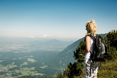 Mountain top view. Woman on top of mountain with beautiful view Royalty Free Stock Photography