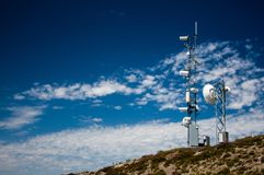 Mountain top weather station with a blue sky royalty free stock photos