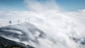 Mountain top of wind farms with clouds Royalty Free Stock Photos