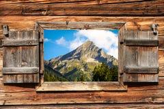 Mountain top through window. View through a wooden window on a sunny mountain top Stock Photography