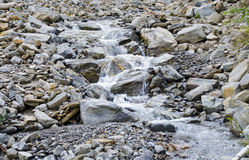 Mountain torrent with boulders Royalty Free Stock Photography