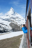 Mountain. Tourist taking photo of Zermatt from the train in Switzerland stock photos