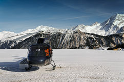 Mountain touristic helicopter in flight Stock Image