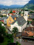 Mountain town. Aerial view of a town in Austria, surrounded by mountains and a blue clouded sky Royalty Free Stock Photography